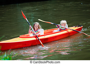 Kids kayaking in summer sport camp