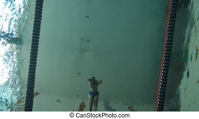Indoor pool swimming slow motion video clip