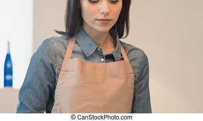 Pleasant beautiful baker sifting flour - Like what you do....
