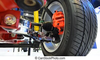 Wheel, brake and suspension parts of the car in show event -...