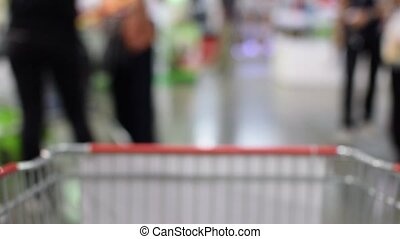 Blurred of Shopping cart in supermarket - Blurred of...