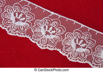 Lace detail - White machine made lace in red cloth