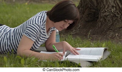 Girl student studying in the park