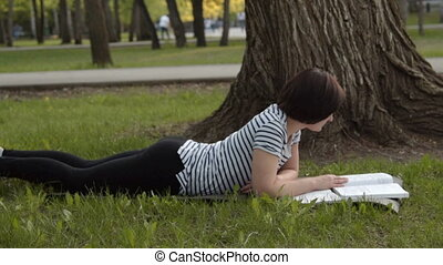 Girl student studying outdoors - Girl student studying in...