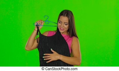 Girl had chosen a black dress Green screen Close up - Young...