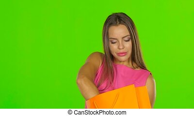 Woman gets out of the package a purchased shoes Green screen...