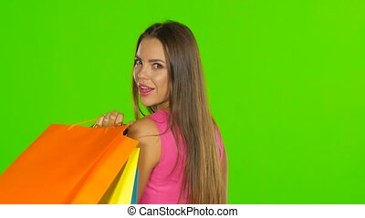 Woman with shopping bags. Green screen. Close up