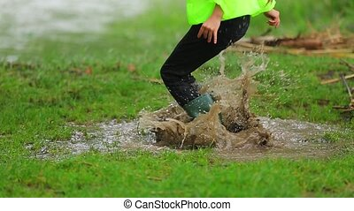 Happy Child Jumping In Muddy Puddle - SLOW MOTION Waist down...