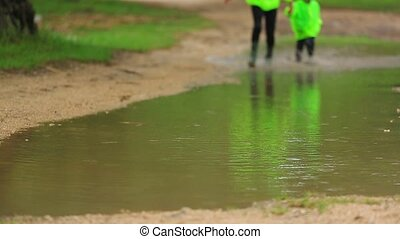 Cute Girl And Boy Having Fun In Huge Puddle - SLOW MOTION....
