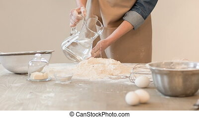 Nice baker making dough - Follow the receipt Pleasant...