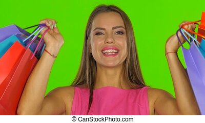 Woman had a successful shopping and smiling. Green screen. Close up