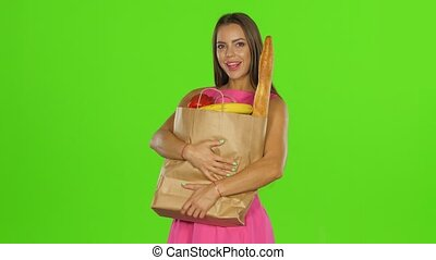 Woman enjoying the aroma of the pepper. Green screen - Woman...