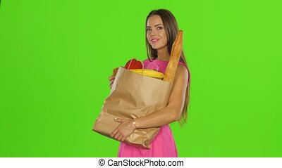 Woman bought food with gold card. Green screen - Young woman...