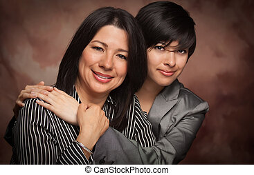 Attractive Multiethnic Mother and Daughter Studio Portrait...