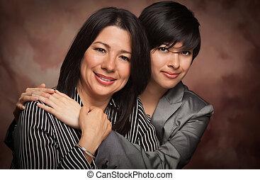 Attractive Multiethnic Mother and Daughter Studio Portrait...