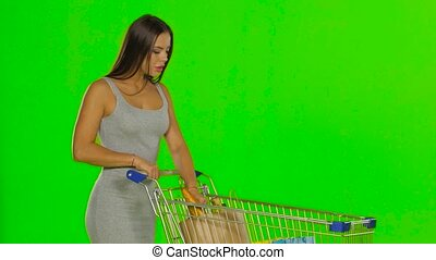 Woman with the food trolley. Green screen - Young woman...