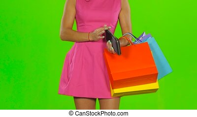 Woman tosses the empty wallet. Green screen - Girl empty...