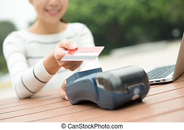 Woman pay by credit crad with NFC technology