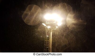 Floodlight and falling snow - Floodlight with falling snow...