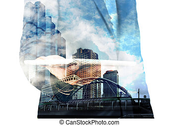 Double exposure of Businessman with Tablet and Modern City...