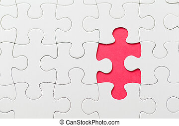 Puzzle with missing piece in red color