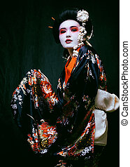 geisha in kimono on black - Young beautiful asian womans...