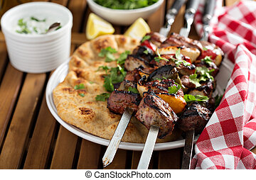 Lamb kebabs with flatbread and tzatziki sauce - Lamb kebabs...