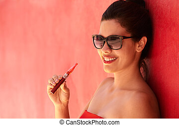 Portrait Girl Smokes Electronic Cigarette E-Cig Against Red...