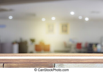 Empty wooden table with some people meeting blur background...