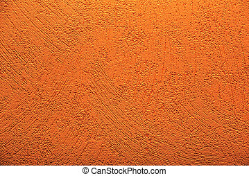 Conceptual shot of orange wallpaper with paint structure