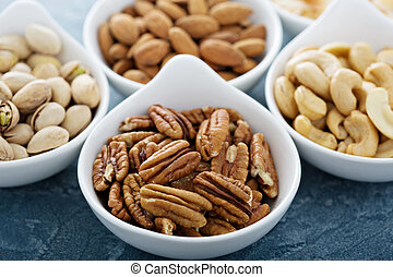 Variety of nuts in small bowls