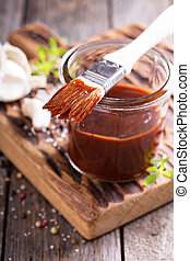 Barbeque sauce in a jar - Barbeque sauce with a basting...