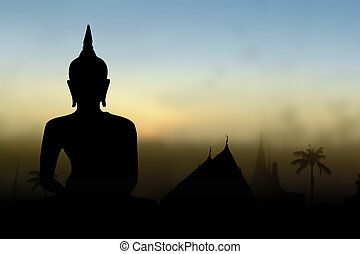 Silhouette public Buddha statue, over sunset in Thailand...