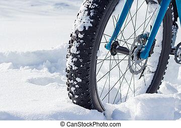 Bike Wheel in Snow - A picture of a fat bike wheel in snow...