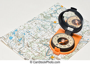 Compass & map - friends travelers. Magnetic compass on a...