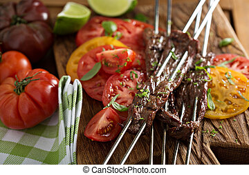 Flank steak on skewers with tomatoes - Flank steak on...