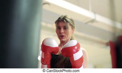 Beautiful brunette boxing pear 4k - beautiful woman in red...