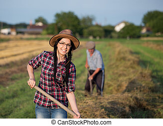 Famer girl working on field - Young pretty farmer girl...