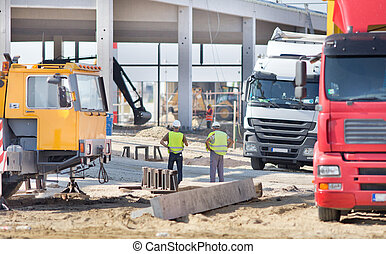 Engineers at construction site - Two construction engineers...