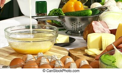 Cooking omelet. To add the beaten egg and milk mix blender.