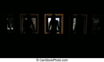 Silhoutte of a girl on a background of a window