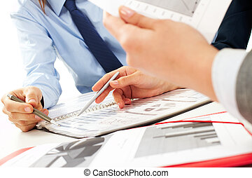 Discussing papers - Close-up of business partners hands over...