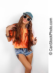 beautiful woman in sunglasses wearing in black hat and...