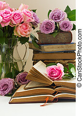 Old books with rose flower
