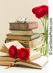 Old books with rose flower - Stack of vintage books with red...