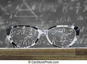 Back to school glasses - glasses on a wooden table in front...