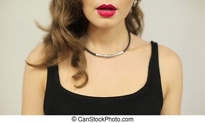 Beautiful woman with red lipstick licking her lips