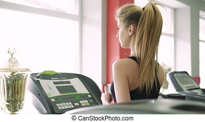 Beautiful blonde on the treadmill at the gym. 4k - Beautiful...