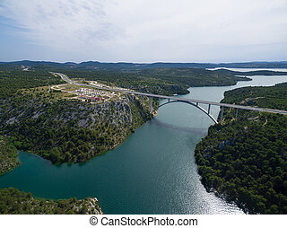 Aerial view of the Krka Bridge spanning the rver, Croatia. -...