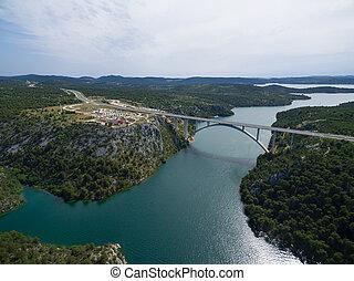 Aerial view of the Krka Bridge spanning the rver, Croatia. -...
